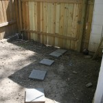 Kevin finished the side gate and we laid the stepping stones.