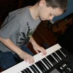 Z doing piano practice