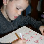 Z marking the phonetic rules on his spelling words