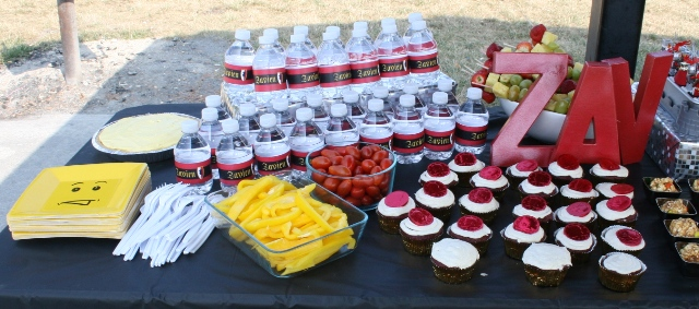 Red & Gold Kingdom: lego face plates, personal labeled water bottles, fruit skewers, red coin cupcakes